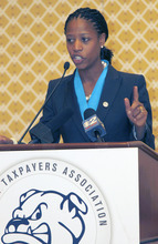 Al Hartmann  |  Tribune file photo Saratoga Springs Mayor Mia Love., here speaking to the Utah Taxpayers Association, is beginning to pile up campaign cash in her bid against Democratic Rep. Jim Matheson.
