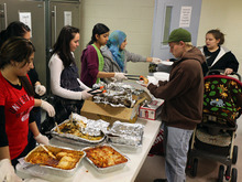 Lennie Mahler  |  Tribune file photo Mia Love's budget plan would include big cuts in food assistance to the poor and homeless shelter funding. In this file photo, volunteers serve dinner to Jason and Justine Coombs in the family area at The Road Home Shelter.