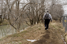 Trent Nelson  |  Tribune file photo John, a homeless man, walks to his tent in a homeless camp along the Jordan River in Salt Lake City last  January.