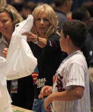 Vice President Joe Biden's wife Jill Biden helps fill bags for a USO service project during the Democratic National Convention in Charlotte, N.C., Thursday, Sept. 6, 2012. (AP Photo/Chuck Burton)