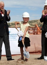 Rick Egan  |  The Salt Lake Tribune  Aumberlee Davis, a 10-year-old undergoing treatment for leukemia, takes the first scoop of dirt at the groundbreaking ceremony for the new George S. and Dolores Doré Eccles Outpatient Services Building on Thursday.