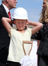 Rick Egan  |  The Salt Lake Tribune  Aumberlee Davis, a 10-year-old undergoing treatment for leukemia, prepares to take the first scoop of dirt at the groundbreaking ceremony for the new George S. and Dolores Doré Eccles Outpatient Services Building on Thursday.