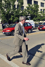 Presiding Judge Edward Burmila leaves the Will County Courthouse in Joliet, Ill., Thursday, Sept. 6, 2012, after a jury convicted former Bolingbrook, Ill., police officer Drew Peterson of murdering his wife, Kathleen Savio, in 2004. He faces a maximum 60-year prison term when sentenced on Nov. 26. Illinois has no death penalty. (AP Photo/Paul Beaty)