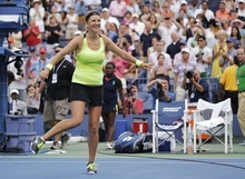 Victoria Azarenka, of Belarus, dances while celebrating her win against Maria Sharapova, of Russia, during a semifinal match at the 2012 US Open tennis tournament,  Friday, Sept. 7, 2012, in New York.   (AP Photo/Mike Groll)
