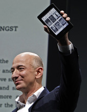 Jeff Bezos, CEO and founder of Amazon, holds the Kindle Paperwhite at the introduction of the new Amazon Kindle Fire HD and Paperwhite devices in Santa Monica, Calif., Thursday, Sept. 6, 2012. (AP Photo/Reed Saxon)