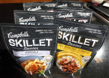 In this Friday, Aug. 24, 2012 photo, Campbell's new Skillet sauces are displayed at the Campbell Soup Company headquarters in Camden, N.J. Campbell Soup Co. last year began a quest that led executives to trendsetting cities including Portland, Ore. and London to figure out how to make soups that appeal to younger, finicky customers. In the year ahead, the 143-year-old company plans to roll out 50 new products such as Moroccan Style Chicken and Spicy Chorizo. (AP Photo/Mel Evans)