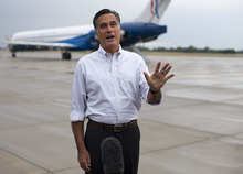 Republican presidential candidate, former Massachusetts Gov. Mitt Romney holds a news conference after landing at Jetsun Aviation Center, Friday, Sept. 7, 2012, in Sergeant Bluff, Iowa.  (AP Photo/Evan Vucci)
