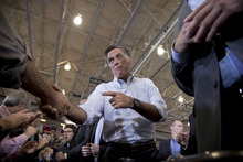 Republican presidential candidate, former Massachusetts Gov. Mitt Romney shakes hands during a campaign rally, Friday, Sept. 7, 2012, in Orange City, Iowa.  (AP Photo/Evan Vucci)