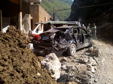 In this photo provided by China's Xinhua News Agency, damaged cars are seen in Luozehe town, Yiliang County, southwest China's Yunnan Province, Friday, Sept. 7, 2012. A series of earthquakes collapsed houses and triggered landslides in a remote mountainous part of southwestern China on Friday, killing dozens of people with the toll expected to rise. Damage was preventing rescuers from reaching some outlying areas, and communications were disrupted. (AP Photo/Xinhua, Zhou Hongpeng) NO SALES