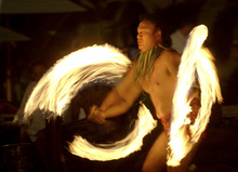 FILE - This Feb. 3, 2005 file photo shows Vise Vitale of Honolulu performing a Samoan fire knife dance during in an