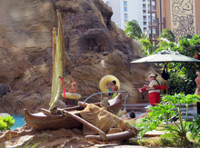 A Hawaiian canoe is seen next to a lazy river swimming pool at Aulani, Disney's resort in Kapolei, Hawaii on Aug. 31, 2012. Many Hawaii resorts are edging away from kitschy marketing inventions and are instead turning to Hawaii's actual rich traditions to make trips special for travelers. (AP Photo/Audrey McAvoy)
