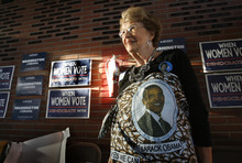 Margaret Munro, of Richland, Wash., listens to the televised 2012 Democratic National Convention  Thursday Sept. 6, 2012 at the Plumbers and Steamfitters Local Union Hall 598 in Pasco, Wash. Munro wears a cloth wrap with a portrait of President Barack Obama made by her friend Fatima Traore's mother who lives in Mali in Africa.  (AP Photo/The Tri-City Herald,Paul T. Erickson ) LOCAL TV OUT; LOCAL RADIO OUT KONA