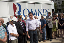 Republican presidential candidate, former Massachusetts Gov. Mitt Romney speaks with the news media after making a stop at the