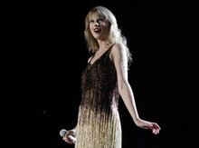 FILE - In this March 2, 2012 file photo, Taylor Swift performs on stage at the Burswood Dome during the opening night of her