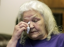 Darlene Bessonette wipes a tear from her face as she makes remarks during a news conference after attorneys filed a wrongful-death case against Salt Lake City police for the Taser death of Allen Nelson Thursday, Sept. 6, 2012, in Salt Lake City. Bessonette, an eyewitness says she overheard police say they used a stun gun on the man. (AP Photo/Rick Bowmer)