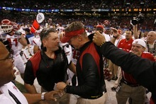 Utah head coach Kyle Whittingham and defensive coordinator Gary Anderson celebrate after the Utes defeated Alabama in the 75th annual Sugar Bowl in New Orleans, Friday, January 2, 2009.  Scott Sommerdorf/The Salt Lake Tribune