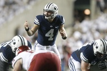 Chris Detrick  |  The Salt Lake Tribune Brigham Young Cougars quarterback Taysom Hill (4) during the first half of the game against Washington State at LaVell Edwards Stadium Thursday August 30, 2012. BYU is winning the game 24-6.