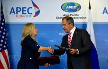 US Secretary of State Hillary Clinton, left, shakes hands with Russian Foreign Minister Sergey Lavrov after signing a Memorandum of Understanding for Cooperation in Antarctica during the Asian-Pacific Economic Cooperation (APEC) Summit in Vladivostok on Saturday Sept. 8, 2012. (AP Photo/Jim Watson, Pool)