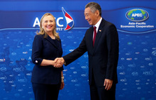 U.S. Secretary of State Hillary Rodham Clinton, left, shakes hands with Singaporean Prime Minister Lee Hsien Loong during a bilateral meeting held on the sidelines of the Asia-Pacific Economic Cooperation (APEC) Summit in Vladivostok, Russia, on Saturday, Sept. 8, 2012. (AP Photo/Jim Watson, Pool)