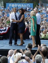 From left, President Barack Obama, first lady Michelle Obama, Jill Biden and Vice President Joe Biden, stand together on stage at a campaign event at Strawbery Banke Field, Friday, Sept. 7, 2012, in Portsmouth, N.H. (AP Photo/Carolyn Kaster)