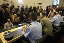 Annecy prosecutor Eric Maillaud, center, speaks during a news conference in Annecy, France, Friday, Sept. 7, 2012. Maillaud said that the 4-year-old girl who survived the slaying of her family in Annecy couldn't help their investigation since she hid under her mother's legs during the killings. (AP Photo/Lionel Cironneau)