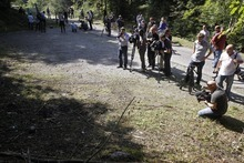 Media picture the crime scene where four people have been shot to death in and near a British-registered car, in a forest in the Alps, near Chevaline, French Alps, Friday Sept. 7, 2012. The case took on international ramifications, with links that tied the slain family to Britain, Iraq and Sweden. (AP Photo/Laurent Cipriani)