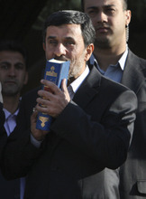 FILE- In this Monday, Sept. 19, 2011 file photo, Iranian President Mahmoud Ahmadinejad, kisses the Quran, Islam's holy book, during his official departure ceremony, as he leaves Tehran's Mehrabad airport, Iran, for New York to attend the UN General Assembly. As Iran's president crafts his talking points for his annual trip to New York, one message is likely to remain near the top: Tehran has not closed the door on nuclear dialogue and is ready to resume negotiations with world powers. (AP Photo/Vahid Salemi, File)