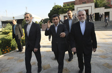 FILE- In this file Monday, Sept. 19, 2011 file photo, Iranian President Mahmoud Ahmadinejad, center, waves to media, while gesturing to the photographer, as he leaves Tehran's Mehrabad airport, Iran, for New York to attend the UN General Assembly. Vice-President Mohammad Reza Rahimi, right, and advisor to the supreme leader, Ali Akbar Velayati, left, accompany him during his official departure ceremony. As Iran's president crafts his talking points for his annual trip to New York, one message is likely to remain near the top: Tehran has not closed the door on nuclear dialogue and is ready to resume negotiations with world powers. (AP Photo/Vahid Salemi, File)