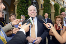 US Senator John McCain answers reporters' questions during a meeting on World Economy in Cernobbio, Italy, Friday, Sept. 7, 2012. Experts and leaders gathered in Italy to discuss the prolonged crisis in a structurally flawed Europe, political dysfunction pushing America off a 'fiscal cliff' and the emerging economies slowdown drying up the last engine of global growth. (AP Photo/Giuseppe Aresu)