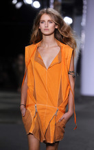 The Edun Spring 2013 collection is modeled during Fashion Week, Saturday, Sept. 8, 2012, in New York. (AP Photo/Jason DeCrow)