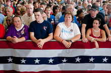 From front left, Wanda Morris, Jonathan Morris, Lesa Dreps, and Kayla and Brian Burke anticipate the arrival of Republican presidential nominee, former Massachusetts Gov. Mitt Romney at a rally with the GOP team at the Military Aviation Museum in Virginia Beach, Va., Saturday, Sept. 8, 2012.  (AP Photo/Rich-Joseph Facun)