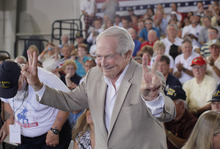 Evangelist Pat Robertson acknowledges the audience before he takes a seat before Republican presidential candidate Mitt Romney campaigns at the Military Aviation Museum in Virginia Beach, Va., Saturday, Sept. 8, 2012. (AP Photo/Charles Dharapak)