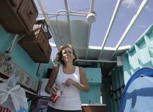 Cabana owner Janet Ryan pauses for a drink while cleaning up her roofless cabana at the Breezy Point Surf Club in the Queens section of New York, Saturday, Sept. 8, 2012, after a possible tornado damaged many of the cabanas.  A tornado swept out of the sea and hit the beachfront neighborhood in New York City, hurling debris in the air, knocking out power and startling residents who once thought of twisters as a Midwestern phenomenon. Firefighters were still assessing the damage, but no serious injuries were reported and the area affected by the storm appeared small. (AP Photo/Kathy Willens)