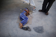 In this Friday, Sept. 7, 2012 photo, Ali Fareed, 8, who fled his home with his family due to fighting between the Syrian army and the rebels, lies on the ground waiting for a doctor's arrival to check on him as he suffers from food poisoning, outside a makeshift clinic, at the Bab Al-Salameh border crossing where he and his family take refugee in hopes of entering one of the refugee camps in Turkey, near the Syrian town of Azaz. Despite rising international concern and new pledges of aid, the plight of Syria's internally displaced is growing worse as fighting shows no signs of slackening and more head for the borders. Syria's neighbors are reluctant to take in more refugees, leaving thousands, at least half young children, stranded on the borders with poor hygiene and insufficient food. At the Bab al-Salameh border crossing there are already an estimated 5,000 refugees hoping to cross into Turkey, which already hosts 80,000 Syrians and isn't allowing more in for now. (AP Photo/Muhammed Muheisen)