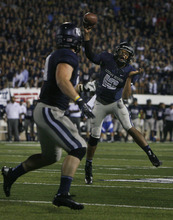 Scott Sommerdorf  |  The Salt Lake Tribune              USU QB Chuckie Keeton throws a four yard TD pass to Kellen Bartlett to give USU a late 20-13 lead. The USU Aggies beat Utah 27-20 in OT, Friday, September 7, 2012.