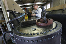Scott Sommerdorf  |  The Salt Lake Tribune              Dave Wagstaff drills holes in the structure of the tender for some of the 5,000 rivets in the restored vehicle. A group of volunteers in Ogden comes together every Saturday to work on restoring a narrow gauge locomotive at the Union Station Trainmen's Building, Saturday, September 8, 2012.