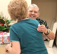 Rick Egan  | The Salt Lake Tribune     LaDean Nielsen hugs Merle Hansen (right) to congratulate her for her 41 years, Thursday, August 16, 2012. Hansen has been a store clerk at the JCPenney store in the Valley Fair Mall for 41 years. She was honored by her work colleagues on Thursday morning, before the store opened to customers.