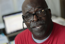 Isaiah Woods, 66, poses in his home office, August 15, 2012, in his apartment on the North Side in Chicago, Illinois. After retirement, he became an independent representative and team trainer for ACN, a home-based network marketing firm. (Chris Walker/Chicago Tribune/MCT)
