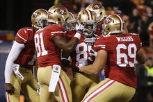 San Francisco 49ers wide receiver Nathan Palmer (89) celebrates with teammates after scoring a touchdown against the San Diego Chargers during the third quarter of an NFL preseason football game in San Francisco, Thursday, Aug. 30, 2012. (AP Photo/Marcio Jose Sanchez)