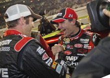 Jeff Gordon celebrates making the chase with crew chief, Alan Gustafson, left, on pit row after the NASCAR Sprint Cup Series auto race at the Richmond International Raceway in Richmond, Va., Sunday, Sept. 9, 2012. (AP Photo/Steve Helber)