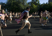 Kim Raff | The Salt Lake Tribune Wearing only underwear people run down 400 South at the start of the 5k Utah Undie Run in Salt Lake City, Utah on September 9, 2012. Thousands of people gathered in hopes of breaking last years record of 2,270 people which was the largest gathering of people wearing only underpants.