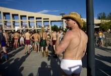 Kim Raff | The Salt Lake Tribune Justin Herrera waits for the beginning of the 5k Utah Undie Run at Library Sqare in Salt Lake City, Utah on September 9, 2012. Thousands of people gathered in hopes of breaking last years record of 2,270 people which was the largest gathering of people wearing only underpants.