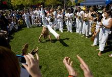 Kim Raff   The Salt Lake Tribune People from the Volta Miuda Capoeira school perform during the 8th annual Brazilian Festival at the Gallivan Center in Salt Lake City, Utah on September 8, 2012.