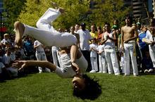 Kim Raff   The Salt Lake Tribune Zac Tipton from the Volta Miuda Capoeira school flips in the air during the 8th annual Brazilian Festival at the Gallivan Center in Salt Lake City, Utah on September 8, 2012.
