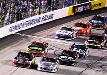 Dale Earnhardt Jr., (88) leads the field at the start of the NASCAR Sprint Cup Series auto race at Richmond International Raceway in Richmond, Va., Saturday, Sept. 8, 2012. (AP Photo/Jason Hirschfeld)