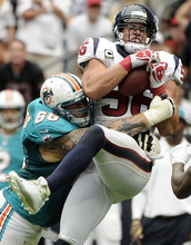 Houston Texans linebacker Brian Cushing (56) intercepts a pass as Miami Dolphins guard Richie Incognito (68) tackles him in the second quarter of an NFL football game, Sunday, Sept. 9, 2012, in Houston. (AP Photo/Dave Einsel)