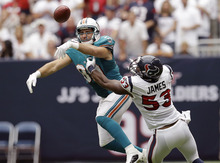 Miami Dolphins tight end Anthony Fasano (80) is prevented from catching the ball by Houston Texans linebacker Bradie James (53) in the first quarter of an NFL football game on Sunday, Sept. 9, 2012, in Houston. (AP Photo/David J. Phillip)