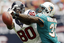 Miami Dolphins defensive back Richard Marshall (31) knocks the ball away from Houston Texans wide receiver Andre Johnson (80) in the second quarter of an NFL football game, Sunday, Sept. 9, 2012, in Houston. (AP Photo/David J. Phillip)