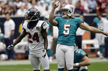 Miami Dolphins kicker Dan Carpenter (5) and Houston Texans cornerback Johnathan Joseph (24) watch the ball go between the goal posts for three points for the Dolphins in the first quarter of an NFL football game on Sunday, Sept. 9, 2012, in Houston. (AP Photo/David J. Phillip)