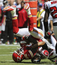 Kansas City Chiefs wide receiver Dwayne Bowe (82) is tackled by Atlanta Falcons cornerback Brent Grimes (20) during the first half of an NFL football game at Arrowhead Stadium in Kansas City, Mo., Sunday, Sept. 9, 2012. (AP Photo/Ed Zurga)